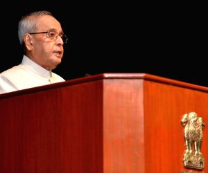 President Mukherjee receives the first copy of the book 'Indian Family Business Mantras'