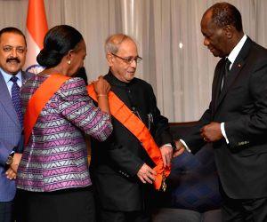 Abidjan (Cote d'Ivoire): Cote d'Ivoire President hosts banquet for President  Mukherjee