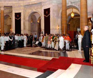 President Mukherjee felicitates scholars