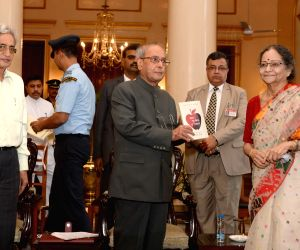 President Mukherjee during presentation of books