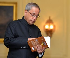 President Mukherjee receives first copy of 'Munger Through the Ages'