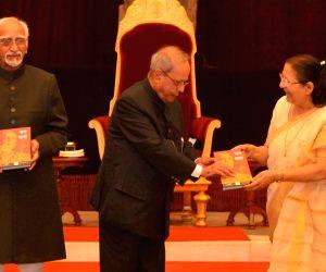 President Mukherjee receives first copy of 'Mann Ki Baat - A Social Revolution of Radio