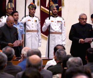 President Ram Nath Kovind administers oath of office to CAG Rajiv Mehrishi