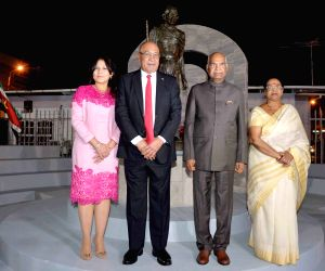 President Ram Nath Kovind, his wife Savita Kovind, Suriname President Desi Bouterse and his wife Ingrid Waldring after paying tributes at the statue of Mahatma Gandhi, in Paramaribo, ...