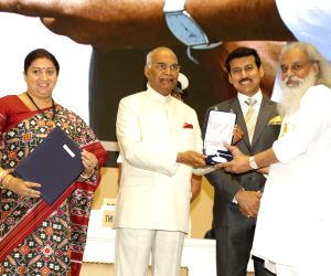 President Ram Nath Kovind presents the Rajat Kamal Award to Padma Vibhushan K.J. Yesudas (Best Male Playback Singer) for the film Viswasapoorvam Mansoor (Malayalam), at the 65th National ...