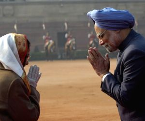 Prime Minister Manmohan Singh and President Pratibha Patil exchange greetings after the ceremonial welcome of the visiting South Korean President Lee Myung-Bak at the Rashtrapati Bhavan in New Delhi on Monday.