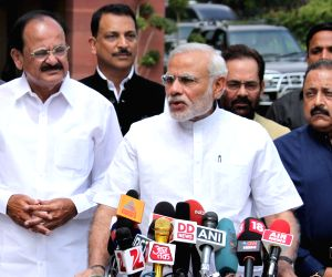Narendra Modi briefs press at the Parliament