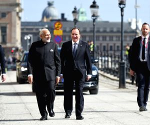 Modi, Swedish PM take a walk from Sager House to Rosenbad