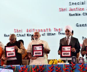 Prime Minister Narendra Modi at the closing ceremony of the Sesquicentennial Celebrations of Allahabad High Court, in Uttar Pradesh on April 2, 2017. Also seen Chief Justice of India ...