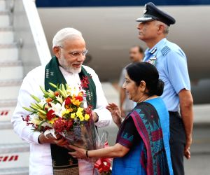 Prime Minister Narendra Modi being welcomed by External Affairs Minister Sushma Swaraj on his arrival in New Delhi on May 12, 2018.