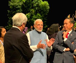 Prime Minister Narendra Modi during an interaction with Singapore Prime Minister Lee Hsien Loong and Indonesian President Joko Widodo ahead of the gala dinner being hosted by Singapore PM, ...