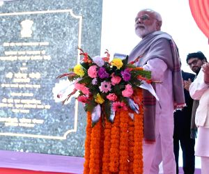 Prime Minister Narendra Modi inaugurates the four laning of the Falakata - Salsalabari section of NH-31 D and Circuit Bench of Calcutta High Court in Jalpaiguri, West Bengal on Feb 8, ...