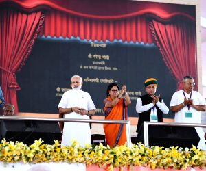 Prime Minister Narendra Modi lays the foundation stone for various urban infrastructure projects in Rajasthan along with Rajasthan Chief Minister Vasundhara Raje and Union Ministers ...