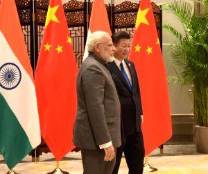 9th BRICS Summit - PM Modi meets Xi Jinping