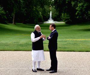 Modi, Emmanuel Macron at Elysee Palace