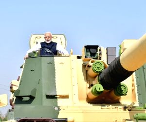 Prime Minister Narendra Modi rides K-9 Vajra Self Propelled Howitzer at Larsen and Toubro (L&T) Armoured Systems Complex at Hazira in Gujarat's Surat, on Jan 19, 2019.