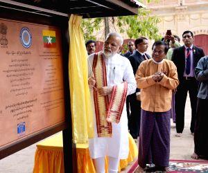 PM Modi unveils a plaque at Ananda Temple