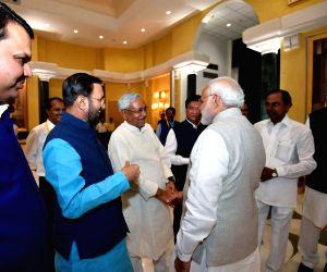 Prime Minister Narendra Modi with Bihar Chief Minister Nitish Kumar, Telangana Chief Minister K Chandrasekhar Rao, Chhattisgarh Chief Minister Raman Singh, Maharashtra Chief Minister ...