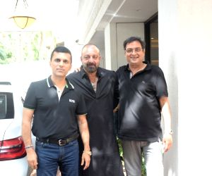 Producer Anand Pandit with actor Sanjay Dutt seen outside his house, in Mumbai on June 16, 2019.