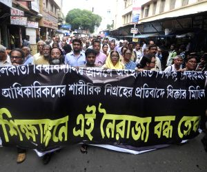 Professor and teaching staff protest against TMC students agitation at Calcutta University