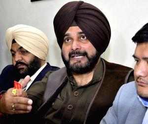 Navjot Singh Sidhu, Gurjeet Singh Aujla during a press conference