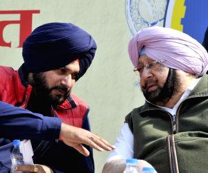 Punjab Chief Minister Captain Amarinder Singh and the state's Cabinet Minister Navjot Singh Sidhu. (Photo: IANS)