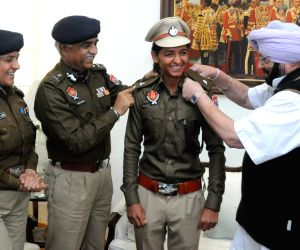 Punjab Chief Minister Captain Amarinder Singh pin stars on Indian woman cricketer Harmanpreet Kaur's uniform as she joined Punjab Police as DSP, in Chandigarh on Mar 1, 2018.