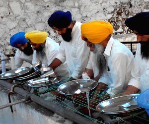 Anandpur Sahib: Bikram Singh Majithia perform 'seva' at Takht Sri Kesgarh Sahib