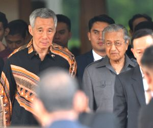 PUTRAJAYA, May 19, 2018 - Malaysian Prime Minister Mahathir Mohamad (R in center) walks with visiting Singaporean Prime Minister Lee Hsien Loong (L in center) after their meeting in Putrajaya, ...