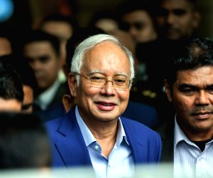Former Malaysian PM arrested, to face fresh charges