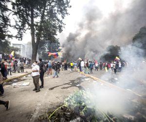 QUITO, Oct. 13, 2019 - Demonstrators participate in a protest in Quito, Ecuador, on Oct. 12, 2019. Ecuadorian President Lenin Moreno declared curfew and militarization of the Metropolitan District of ...