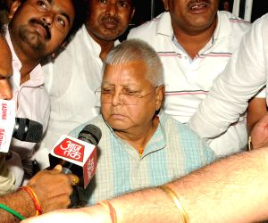 Ranchi: Convicted RJD chief Lalu Prasad Yadav arrives at the Birsa Munda International Airport after being released from the Birsa Munda Central Jail, in Ranchi on May 16, 2018. Apart from a three day parole to attend the marriage of his elder son Te