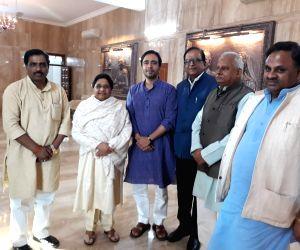 Rashtriya Lok Dal (RLD) leader Jayant Chaudhary meets BSP supremo Mayawati at her residence in Lucknow, on March 16, 2019. (Phoot: IANS)