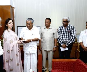 Reliance Foundation Chairperson Nita M Ambani hands over a cheque of Rs. 21 crores to Kerala Chief Minister Pinarayi Vijayan towards the Chief Minister's Relief Fund on Aug 30, 2018. ...