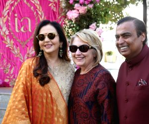 Reliance Industries Chairman Mukesh Ambani and his wife Nita Ambani receive Former First Lady and former US Secretary of State Hillary Clinton on her arrival at the pre-wedding function of ...