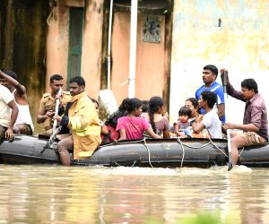 People being rescued after heavy rains
