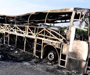 Private bus catches fire killing nine