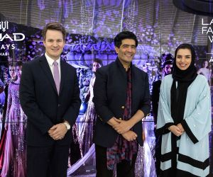 Renowned Indian fashion couturier Manish Malhotra is pictured at Etihad Airways? Innovation Centre in Abu Dhabi, flanked by airline management, Patrick Pierce, Vice President Sponsorships (left), and ...