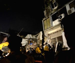Rescue team search for survivors at site of the building collapsed