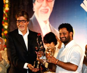 Resul Pukootty is ecstatic as he displays all his awards during an award ceremony in which he was awarded by Amitabh Bachchan for his contribution to sound industry on behalf of  Western India Motion Pictures & TV sound engineers association in Mumbai yesterday night Resul Pukootty is ecstatic as he shows off his Oscar trophy to Amitabh Bachchan at an award ceremony.