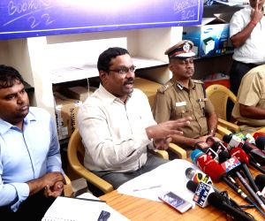 Returning Officer Praveen Nair addresses a press conference to tell television channels to not to telecast the video clip of the late J. Jayalalithaa purportedly on her hospital bed, in ...