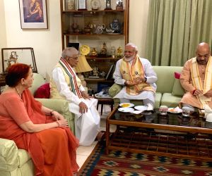 rime Minister Narendra Modi and BJP chief Amit Shah meet senior party leader Murli Manohar Joshi, in New Delhi on May 24, 2019. The BJP on Thursday recorded a stunning and historic ...