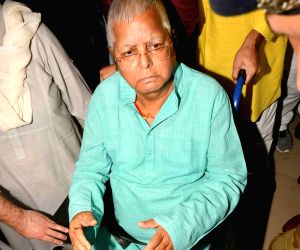 RJD chief Lalu Yadav arrives in Patna on May 10, 2018. Lalu Prasad was received by his elder daughter and Rajya Sabha member Misa Bharti, his sons - former Health Minister Tej Pratap Yadav and ...