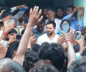 Tejashwi Yadav meets the family of murdered RLSP leader
