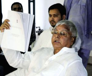 Lalu Yadav addresses a press conference