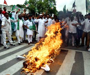 RJD workers stage a demonstration against Bihar Chief Minister Nitish Kumar in Patna, on June 18, 2018.