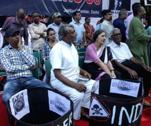 Safai Karamchari Andolan (SKA) members and CPI-M workers led by party leaders D. Raja and Brinda Karat stage a demonstration against the death of sanitation workers during cleaning up of ...