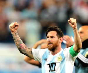 SAINT PETERSBURG, June 26, 2018 (Xinhua) -- Lionel Messi of Argentina celebrates victory after the 2018 FIFA World Cup Group D match between Nigeria and Argentina in Saint Petersburg, Russia, June 26, 2018. Argentina won 2-1 and advanced to the round