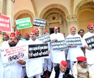 Samajwadi Party (SP) legislators stage a demonstration at Vidhan Bhawan premises in Lucknow to protest against the killings in Sonbhadra and the killing of two cops in Sambhal on July 18, ...