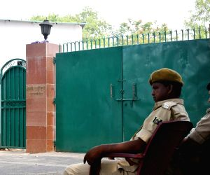 Security personnel outside former Bihar Chief Minister and RJD leader Rabri Devi's residence during CBI interrogation, in Patna on May 22, 2018. The CBI on Tuesday searched former Bihar Chief ...